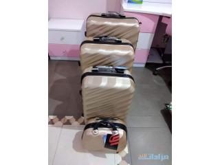 حقائب سفر بعجلات - ذهبي